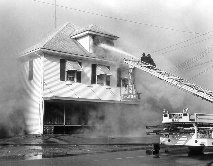 Firefighters Richie Lostritto and Harry Cubbellotti were on Ladder One that day.  (Photo by John Mongillo, Jr.)